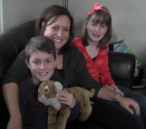 Duncan MacLaren with the stuffed tiger that used to be bigger than he was. Sitting next to him are his mom, Laura Kent, and sister, Meghan MacLaren.